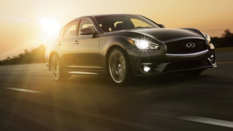 INFINITI Q70 Luxury Sedan Safety Front Action Sunset Road