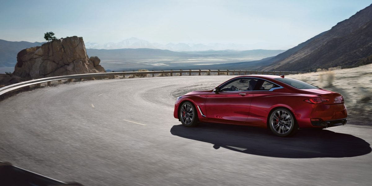 INFINITI Q60 Sporty Coupe Performance Exterior Red Mountain Road