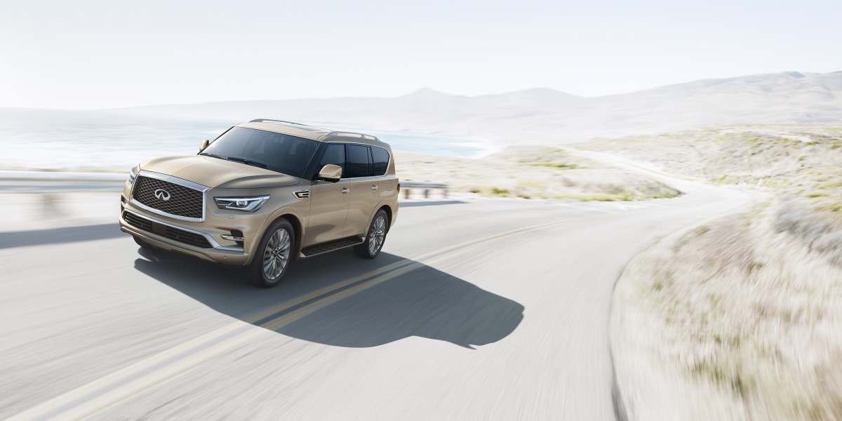 2018 INFINITI QX80 Luxury SUV Exterior Front Three Quarter View in Champagne Quartz