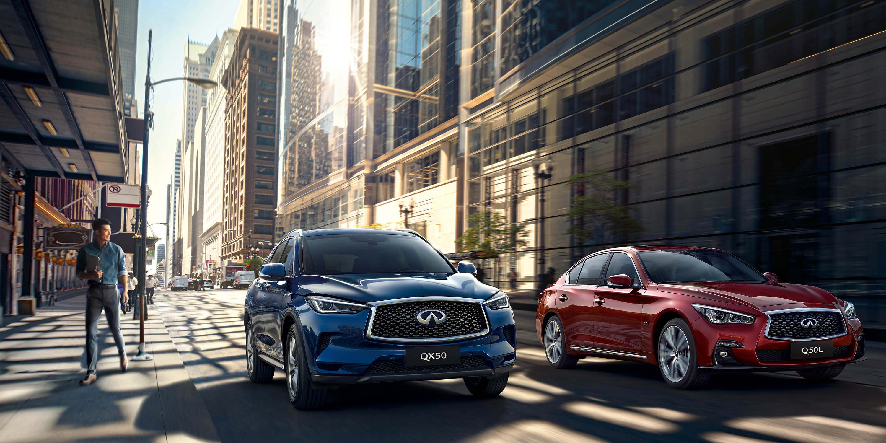 A 2021 INFINITI QX50 graphite shadow exterior crossover driving fast on the road