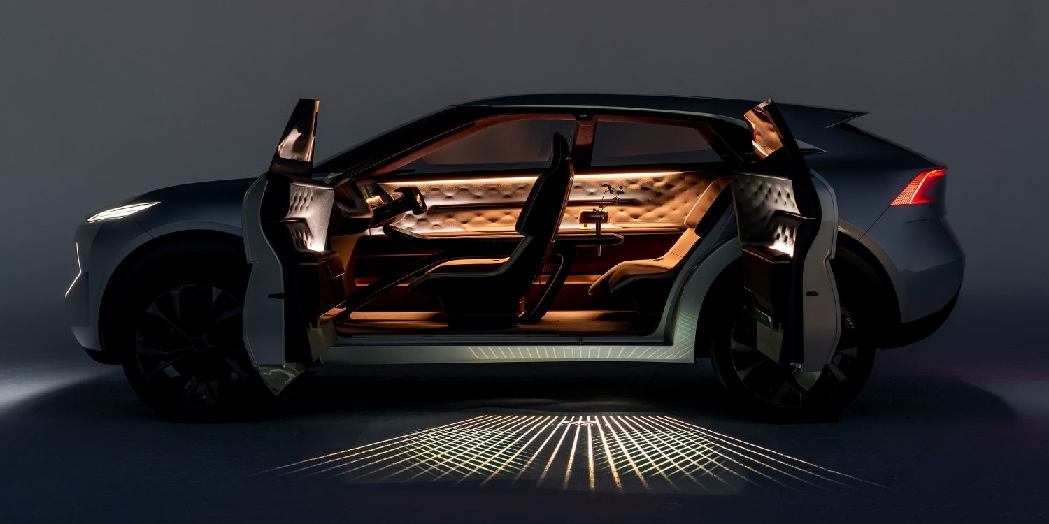 Infiniti QX Inspiration side view with doors open interior view
